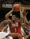 UNLV's Oscar Bellfield (0) drives past the defense of Boise State during the second half of an NCAA college basketball game on Wednesday, Jan. 25, 2012 in Boise, Idaho. UNLV went on to win 77-72.