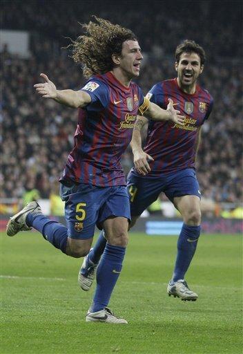 FC Barcelona's Carles Puyol, Left, Celebrates