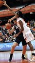 Connecticut's Stefanie Dolson has the ball knocked loose by Syracuse's Kayla Alexander during the second half of an NCAA college basketball game in Syracuse, N.Y., Wednesday, Jan. 25, 2012. Connecticut won 95-54.