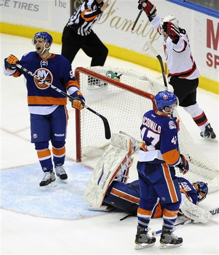 New York Islanders' Frans Nielsen (51) And Andrew MacDonald (47) React As