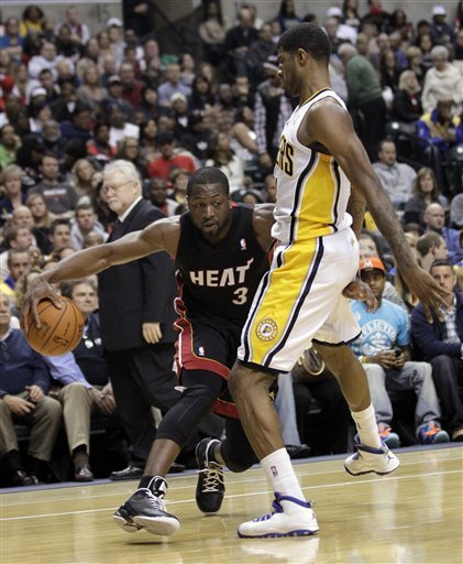 Miami Heat Guard Dwyane Wade, Left, Drives