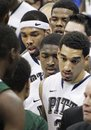 Pittsburgh's Cameron Wright, right, Ashton Gibbs, center, J.J. Moore, left, and Nasir Robinson, top, shake hands with Wagner players after losing their second NCAA college basketball game of the season on Friday, Dec. 23, 2011, in Pittsburgh. Wagner upset Pittsburgh 59-54.