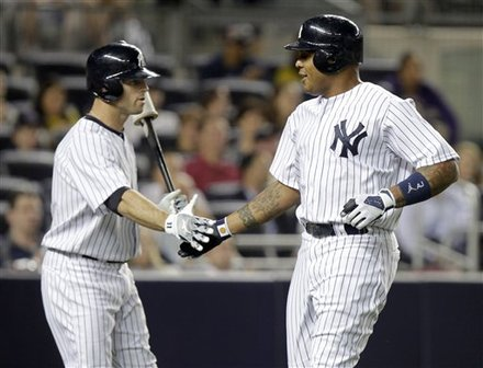New York Yankees' Andruw Jones, Right, Is