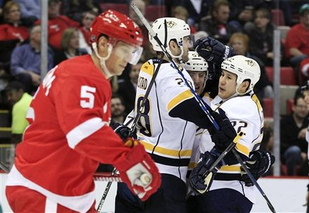 Detroit Red Wings Defenseman Nicklas Lidstrom (5), Of Sweden, Skates By Nashville Predators Left Wing Gabriel Bourque,