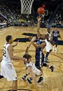 Michigan forward Jordan Morgan, left, watches guard Zack Novak, bottom, try to draw a charge from Penn State guard Jermaine Marshall in the first half of an NCAA college basketball game, Thursday, Dec. 29, 2011, at Crisler Arena in Ann Arbor, Mich. Michigan won 71-53.
