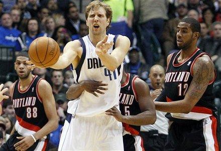 Dallas Mavericks Forward Dirk Nowitzki, Of Germany (41), Is Pressured By Portland Trail Blazers Guard Raymond Felton (5)