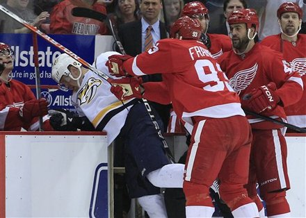 Detroit Red Wings Right Wing Johan Franzen (93), Of Sweden, Checks Nashville Predators Right Wing Patric Hornqvist (27),