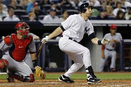 Los Angeles Angels Catcher Chris Iannetta Watches New York Yankees' Mark Teixeira Hit A Third-inning RBI Double That
