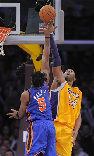 Los Angeles Lakers Guard Kobe Bryant, Right, Blocks