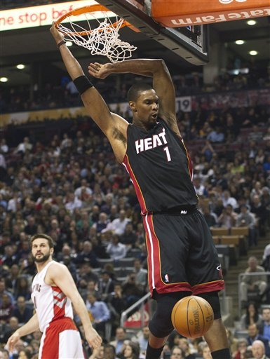 Miami Heat Forward Chris Bosh Dunks