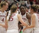 Stanford's Nnemkadi Ogwumike, second from right, speaks with teammates during a second-half time out at an NCAA college basketball game against California , Saturday, Jan. 28, 2012, in Stanford, Calif.