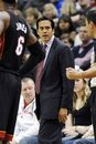 Miami Heat coach Erik Spoelstra argues with a referee in the second half of an NBA basketball game against the Minnesota Timberwolves , Friday, Dec. 30, 2011, in Minneapolis. The Heat won 103-101.