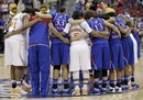 Kansas and Tennessee players pray together at the end of their NCAA women's tournament regional semifinal college basketball game in Des Moines, Iowa, Saturday, March 24, 2012. Tennessee won 84-73.