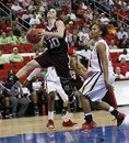 Texas A&M 's Alexia Standish (10) drives past Maryland's Alyssa Thomas during the second half of an NCAA college women's tournament regional semifinal basketball game in Raleigh, N.C., Sunday, March 25, 2012. Maryland won 81-74.