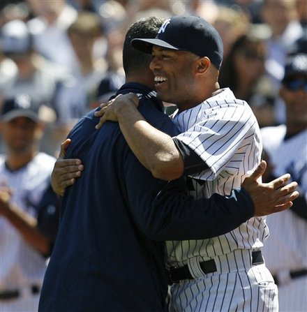 New York Yankees Closer Mariano Rivera, Right, Embraces