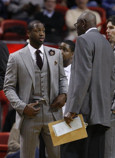 Miami Heat Guard Dwyane Wade, Left, Talks