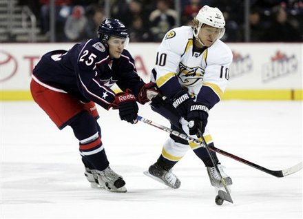 Nashville Predators' Martin Erat, Right, Of The Czech Republic, And Columbus Blue Jackets' Ryan Russell Work For The