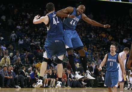 Minnesota Timberwolves'  Kevin Love (42) And Anthony Tolliver (44) Celebrate Against The Golden State Warriors
