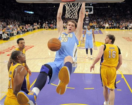 Denver Nuggets Center Timofey Mozgov (25), Of Russia, Dunks The Ball As Los Angeles Lakers Center Andrew Bynum, Left,