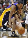 Los Angeles Lakers ' Andrew Goudelock , left, and Milwaukee Bucks ' Carlos Delfino scramble for the loose ball during the second half of an NBA basketball game on Saturday, Jan. 28, 2012, in Milwaukee. The Bucks defeated the Lakers 100-89.