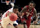 Stanford's Chasson Randle (5) and Massachusetts' Freddie Riley (4) chases down the loose ball during the second half of an NIT men's college basketball tournament semifinal game, Tuesday, March 27, 2012, in New York. Stanford won 74-64.