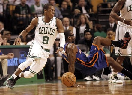 Boston Celtics Point Guard Rajon Rondo (9) Turns With The Ball As New York Knicks' Amare Stoudemire Falls To The Floor