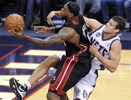 Miami Heat Forward LeBron James, Left, Is