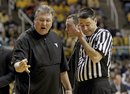 West Virginia head coach Bob Huggins argues with referee Pat Driscoll during the second half of an NCAA college basketball game at WVU Coliseum in Morgantown, W.Va., on Monday, Jan. 30, 2012. Pittsburgh won 72-66.