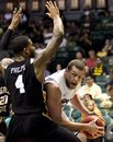 Xavier center Kenny Frease tries to get around Long Beach State forward Eugene Phelps during the second half of the NCAA college basketball game at the Stan Sheriff Center Thursday, Dec. 22, 2011 in Honolulu.