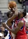Detroit Pistons ' Rodney Stuckey , left, and  Philadelphia 76ers ' Elton Brand collide in the first half of an NBA basketball game, Tuesday, Feb. 28, 2012, in Auburn Hills, Mich. Brand was whistled for a personal foul on the play.