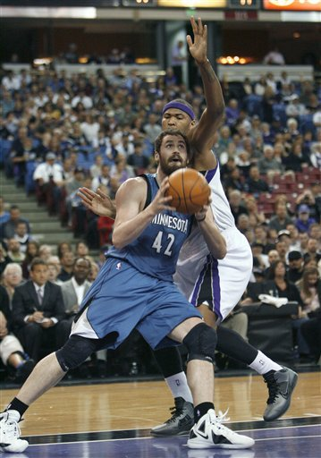 Minnesota Timberwolves Forward Kevin Love, Left, Drives To The Basket Around Sacramento Kings Defender DeMarcus Cousins