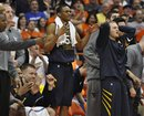 West Virginia players react to a missed scoring opportunity against Syracuse late in the second half in an NCAA college basketball game in Syracuse, N.Y., Saturday, Jan. 28, 2012. Syracuse won 63-61.