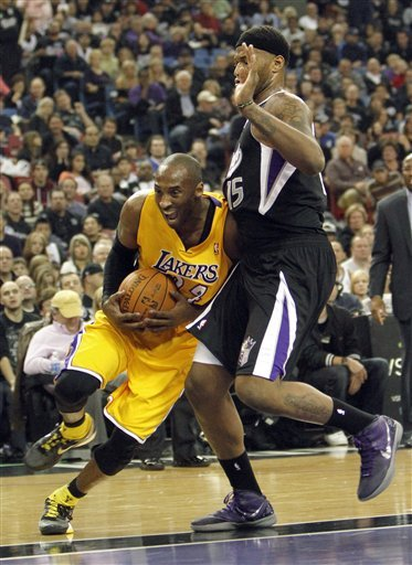 Los Angeles Lakers Guard Kobe Bryant, Left, Drives