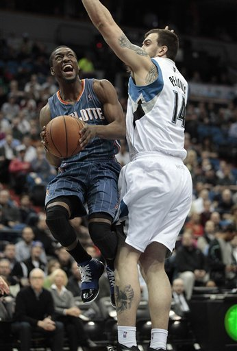 Charlotte Bobcats Guard Kemba Walker, Left, Goes