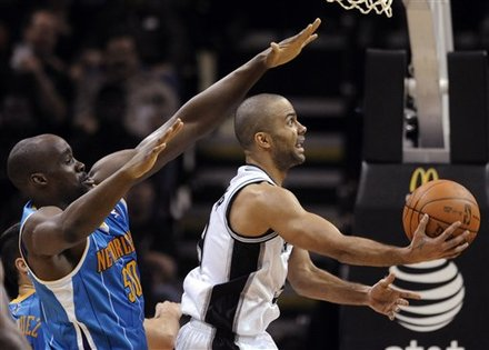 San Antonio Spurs Guard Tony Parker, Of France, Attempts A Layup In Front Of New Orleans Hornets Center Emeka Okafor