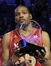 Western Conference's Kevin Durant , of the Oklahoma City Thunder , hoists the Most Valuable Player trophy following the NBA All-Star basketball game, Sunday, Feb. 26, 2012, in Orlando, Fla. The Western Conference won 152-149.
