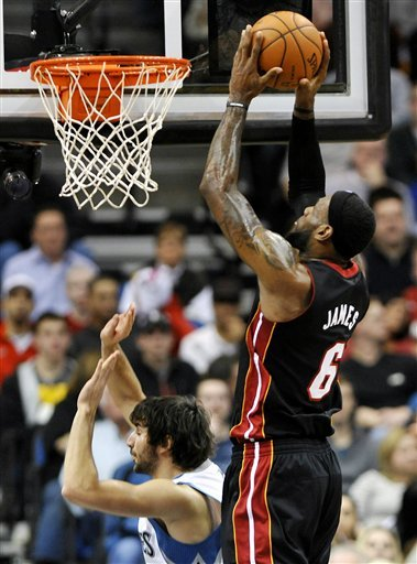 Miami Heat's LeBron James, Right, Goes