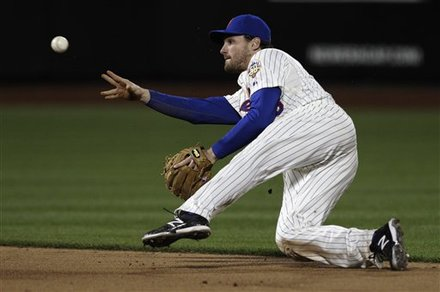 New York Mets Second Baseman Daniel Murphy Throws To Shortstop Ruben Tejada To Put Out Washington Nationals' Ian