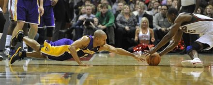 Los Angeles Lakers' Derek Fisher, Left, Dives For The Loose Ball As The Milwaukee Bucks' Luc Richard Mbah A Moute Grabs