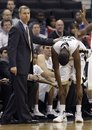 Wake Forest coach Jeff Bzdelik, left, puts his hand on Travis McKie, right, after McKie fouled out during the second half of Wake Forest's 75-52 loss to Florida State in an NCAA college basketball game in Winston-Salem, N.C., Wednesday, Jan. 25, 2012.