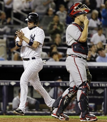 New York Yankees' Chris Stewart, Left, Reacts As He Runs Past Atlanta Braves Catcher David Ross To Score On Derek