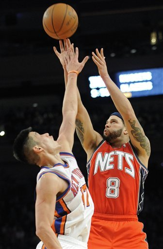 New Jersey Nets Guard Deron Williams, Right, Puts