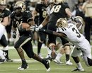 Purdue's Akeem Shavers , left, avoids Western Michigan 's Johnnie Simon on a 14-yard run in the fourth quarter of the Little Caesars Pizza Bowl college football game Tuesday, Dec. 27, 2011, in Detroit. Purdue defeated Western Michigan 37-32.