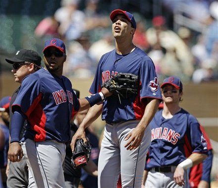 Cleveland Indians Starting Pitcher Ubaldo Jimenez, Center, Yells At Colorado Rockies' Troy Tulowitzki As He Is Held