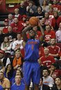 Florida's Kenny Boynton (1) takes a shot during the second half of an NCAA college basketball game against Rutgers in Piscataway, N.J., Thursday, Dec. 29, 2011. Rutgers won 85-83 in double overtime. Boynton had 26 points for Florida .