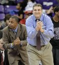 TCU head coach Jim Christian, front, and assistant coach Reggie Brown, left, cheer their team from the bench late in the second half of an NCAA college basketball game against UNLV Tuesday, Feb. 14, 2012, in Fort Worth, Texas. TCU defeated UNLV 102-97.