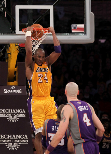 Kobe Bryant #24 Of The Los Angeles Lakers Reverse Dunks