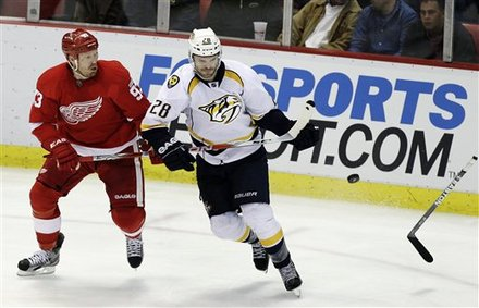 Nashville Predators Center Paul Gaustad (28), Defended By Detroit Red Wings Right Wing Johan Franzen (93), Of Sweden,