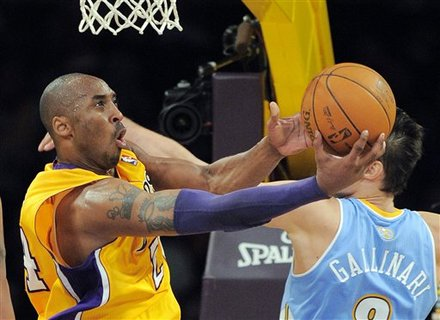 Los Angeles Lakers Guard Kobe Bryant, Left, Puts Up A Shot As Denver Nuggets Forward Danilo Gallinari, Of Italy,