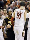 Missouri guard Marcus Denmon, left, confronts Texas center Clint Chapman (53) after scrambling for a rebound on the final play of their NCAA college basketball game, Monday, Jan. 30, 2012, in Austin, Texas. Missouri won 67-66.